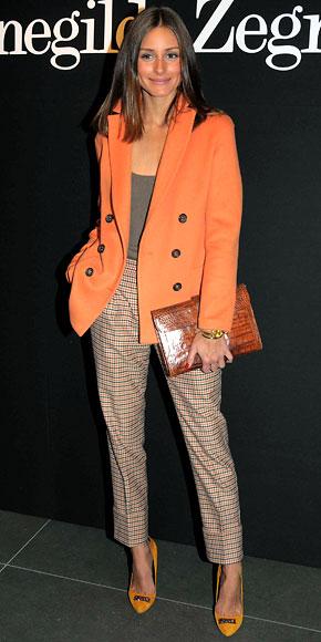 Olivia Palermo in plaid Agnona Zegna slacks with an orange blazer at the Ermenegildo Zegna Milan runway show