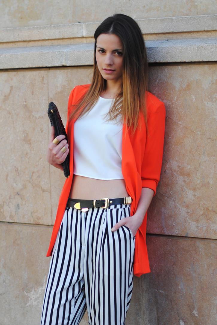 Orange blazer and strappy white pants