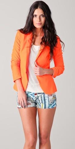Orange blazer with white shirt and shorts