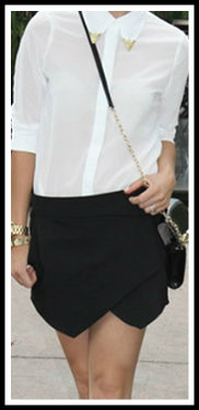 White shirt with black skort- Credits to respective website