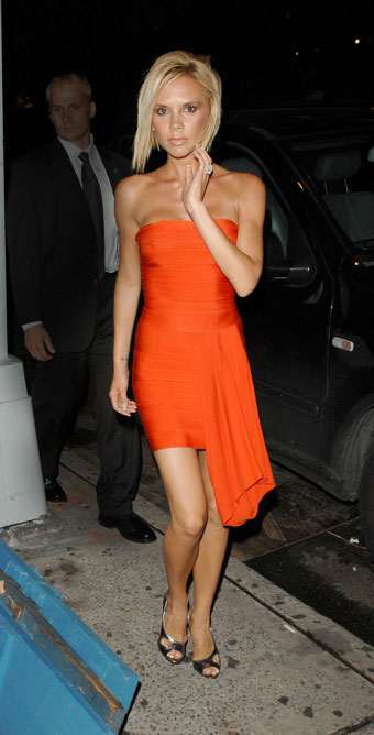 Victoria Beckham in Orange source : www.celebrities.biteus.com