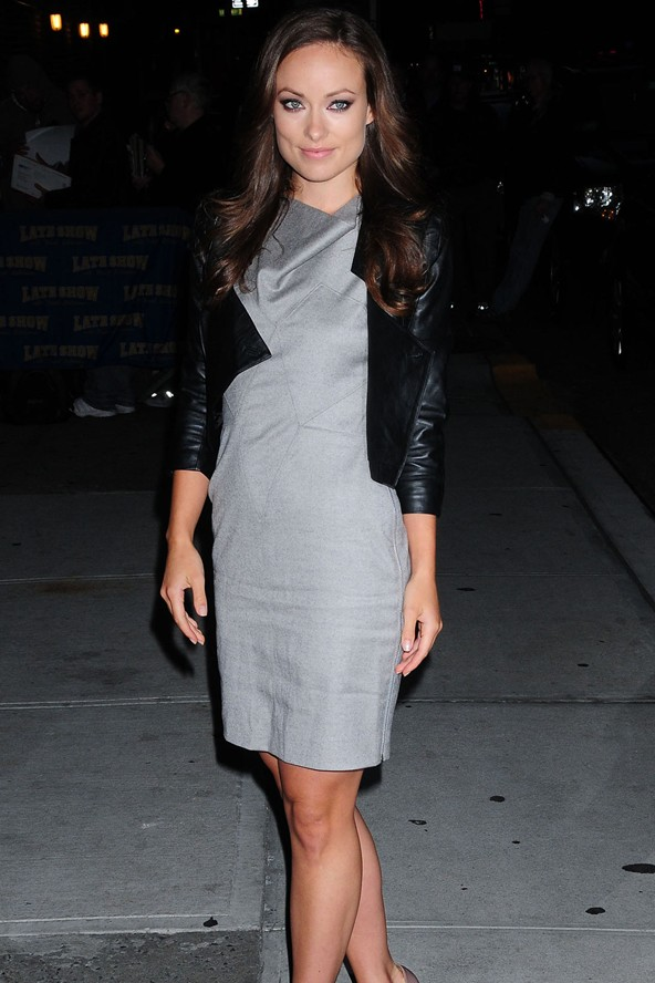 Olivia Wilde teems a leather jacket with grey shift dress