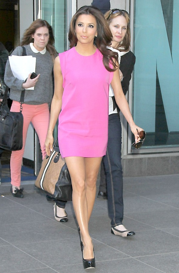 Eva Longoria in a bright pink shift dress